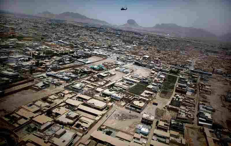 Hodges flies a helicopter over Kandahar city. The city sprawls like Los Angeles — without the skyscrapers. The operation will add hundreds of U.S. military and Afghan police to strengthen security at new police stations in the city. Security checkpoints are being set up on the city's outskirts, and in rural areas of the province U.S. and allied troops will seek to drive out Taliban fighters.