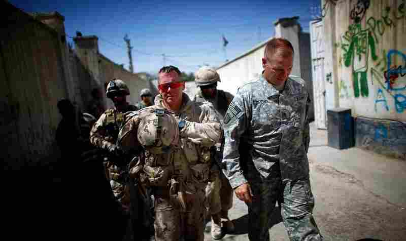 Canadian Brig. Gen. Jonathan Vance (left) walks with Hodges down a Kandahar street.