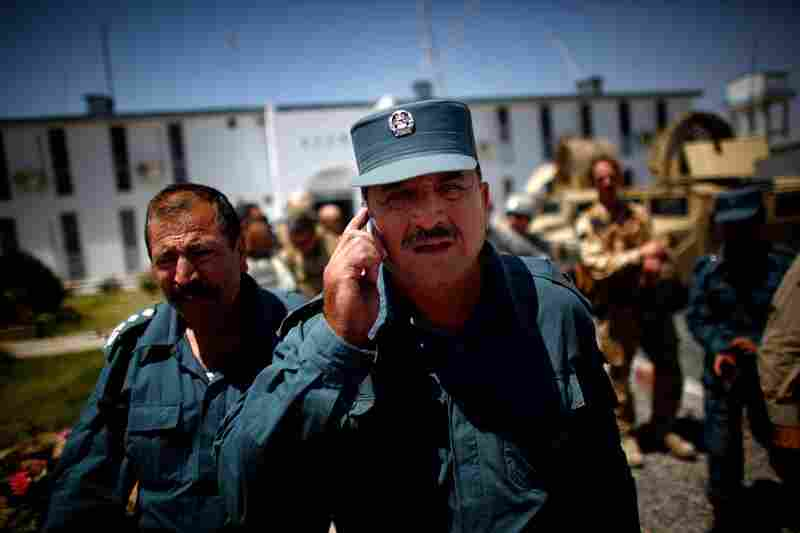 The national police, regarded as more professional than local police, are assisting with the Kandahar operation. Corruption of public officials is one of the biggest problems in Afghanistan. Kandahar's police chief, Sardar Mohammad Zazai, talks on his cell phone outside national police headquarters.