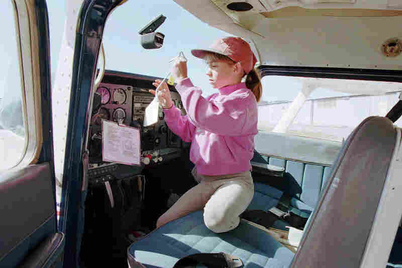 In 1996, while attempting to set a new cross-country record, Jessica Dubroff, 7, died when her plane crashed in Wyoming, killing all on board: Jessica, her father and her flight instructor. Because of legislation motivated by this crash, it is no longer legal in the U.S. for student pilots to attempt to set records. Jessica is pictured here performing pre-flight checks inside the cockpit of a C...