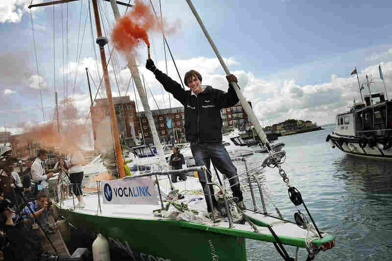 "Only six weeks after Zac Sunderland's record,17-year-old Mike Perham of the U.K. set a new one, beating Sunderland's age by two months. Here Perham lights a flare aboard his yacht ""Totallymoney.com"" after arriving in Portsmouth, U.K., on Aug. 29, 2009."