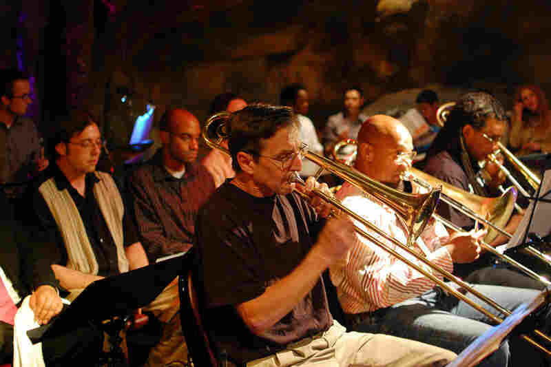 The trombone section (L-R): Steve Shaw, Greg Boyer and DuPor Georges. Trumpeters Mark Chuvala and Leo Maxey are visible behind them.