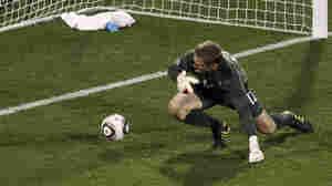 England goalkeeper Robert Green fails to stop a goal.