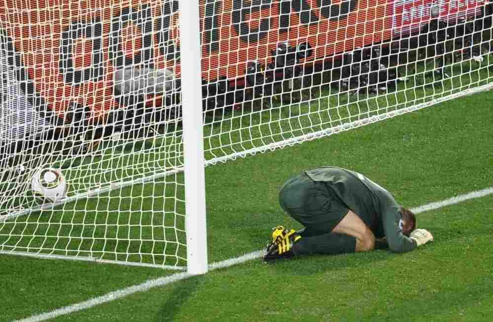 England's goalkeeper Robert Green reacts