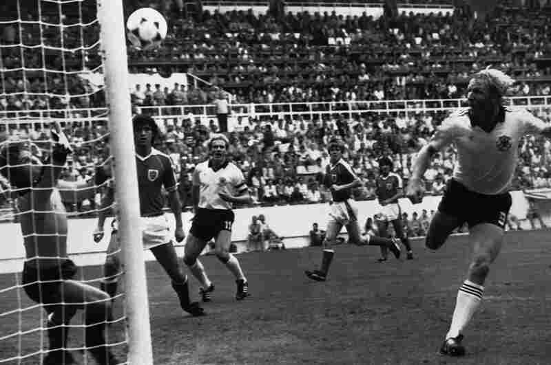 1982: With the knowledge that a 1-0 win for West Germany against Austria would enable both teams to qualify for the next round, the infamous 1982  match was widely accused of being fixed. As a result of this, FIFA ruled that all future final group matches were to take place simultaneously. In this photo, Horst Hrubesch of West Germany scores the only goal of the match.