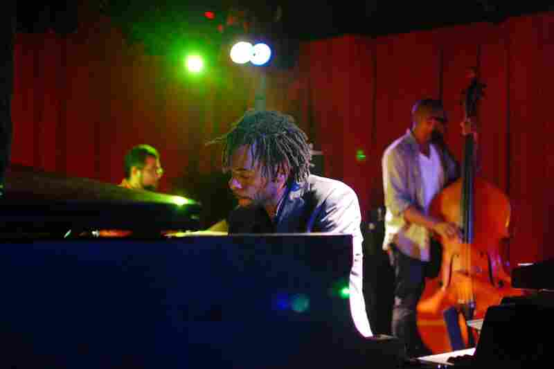 The New York version of the Marc Cary Focus Trio, performing at Sullivan Hall. Cary (piano) is joined by Burniss Earl Travis on bass and Sameer Gupta on drums.