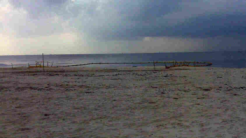 A Pascagoula beach with the boom around one of the drainage outflows