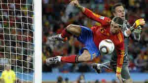 Spain defender Sergio Ramos challenges Swiss goalkeeper in Spain's World Cup loss.