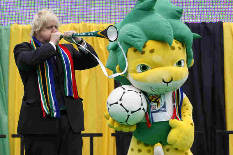 Mayor Boris Johnson of London blows a vuvuzela beside the South Africa World Cup's mascot, Zakumi, during a special event to mark the start of the tournament.