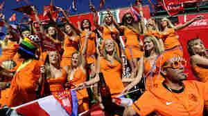 Dutch women in orange miniskirts cheer o