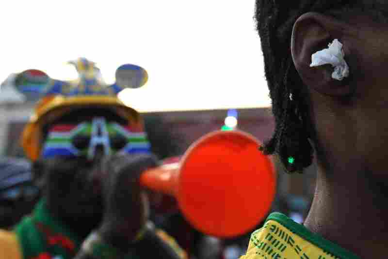 The vuvuzela is iconic to South Africa's soccer culture, but players, fans and broadcasters alike complain of the highly disruptive noise the plastic horn produces. In this photo, a fan uses paper earplugs to block the sound of the horn.