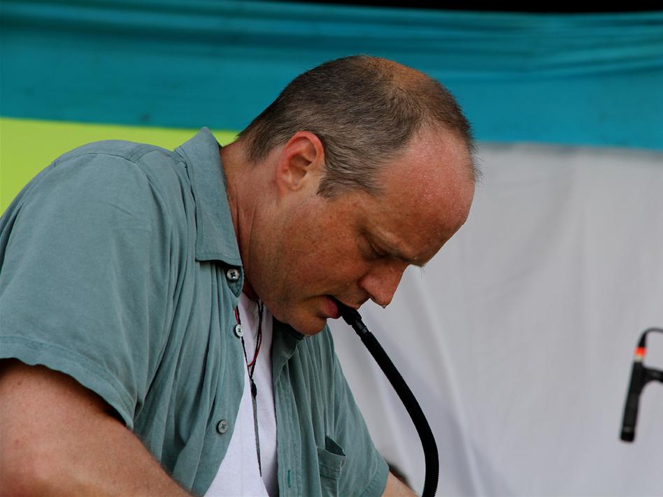 John Medeski plays a melodica at Bonnaroo 2010.