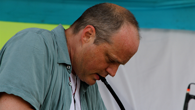 John Medeski plays a melodica at Bonnaroo 2010. (NPR)