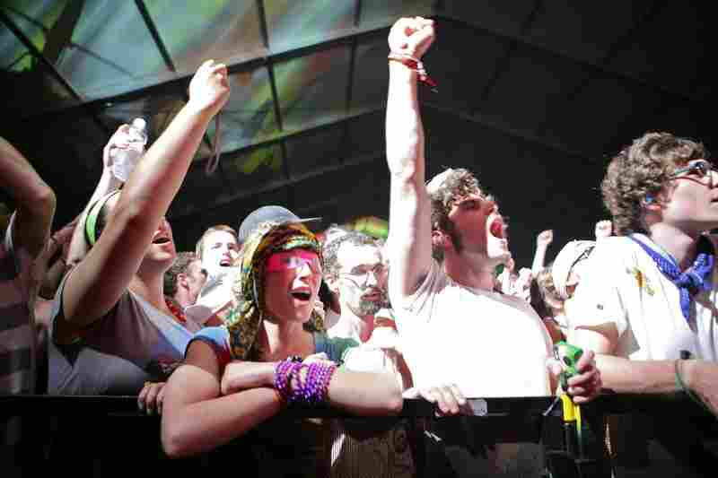 The crowd yells as Dan Deacon takes the stage at Bonnaroo 2010.