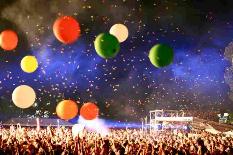 The crowd celebrates amidst confetti and balloons during The Flaming Lips' show at Bonnaroo 2010.