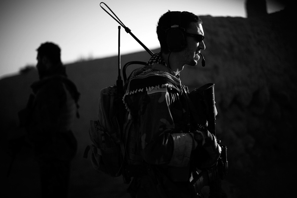 "Capt. Dan of the Green Berets (the U.S. Army Special Forces can only give journalists their first names) on patrol in the village of Ezabad. Together, the American and Afghan special forces are conducting what they call ""village stability operations."""