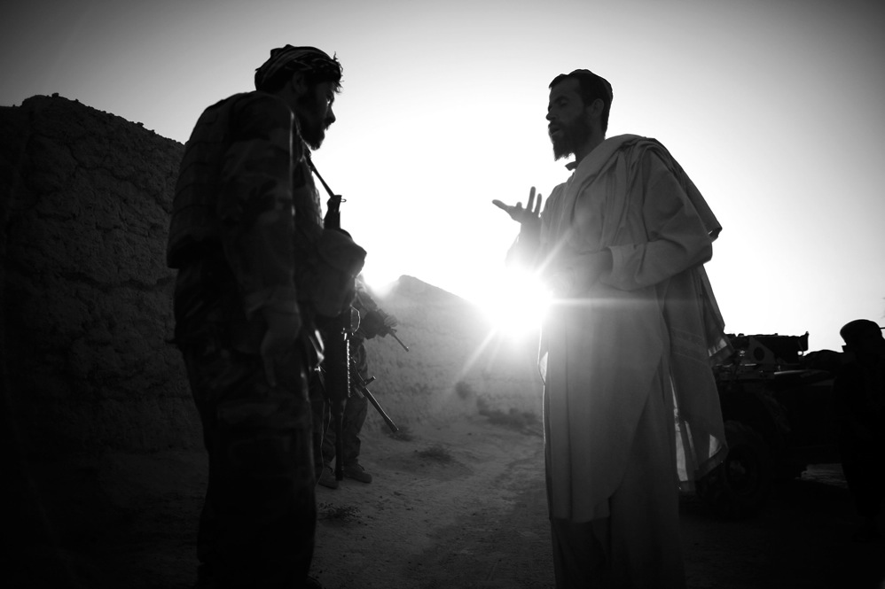 Capt. Dost (left) talks with a local resident in Ezabad in Afghanistan's Kandahar province. While American efforts may fall on deaf ears, Afghan villagers have been inclined to facilitate the efforts of the Afghan special forces.
