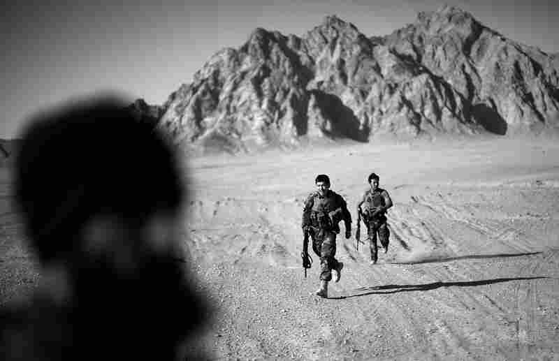 Two members of the Afghan army's first-ever special operations team in southern Afghanistan. The team was deployed in the field just weeks ago and has been joined by teams of U.S. Army Special Forces in a collaborative security effort outside of Kandahar city.