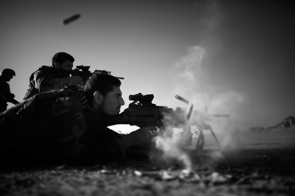 American and Afghan soldiers fire side by side during a shooting exercise in the desert near Ezabad. When not on regular patrols, the Afghan and U.S. special forces are training for the next mission.