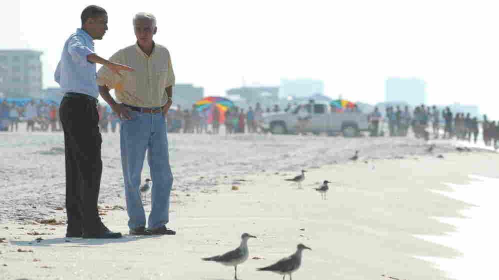 President Barack Obama  and Florida Gov. Charlie Crist on the Pensacola beach Tuesday.