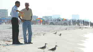 President Barack Obama  and Florida Gov. Charlie Crist on the Pensacola beach Tuesday.