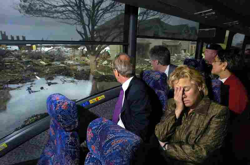 The Netherlands Ambassador Boudewijn J. Van Eellennaam looks outside a bus window on a 2005 tour of the devastation caused by Hurricane Katrina as Louisiana Sen. Mary Landrieu succumbs to the moment.
