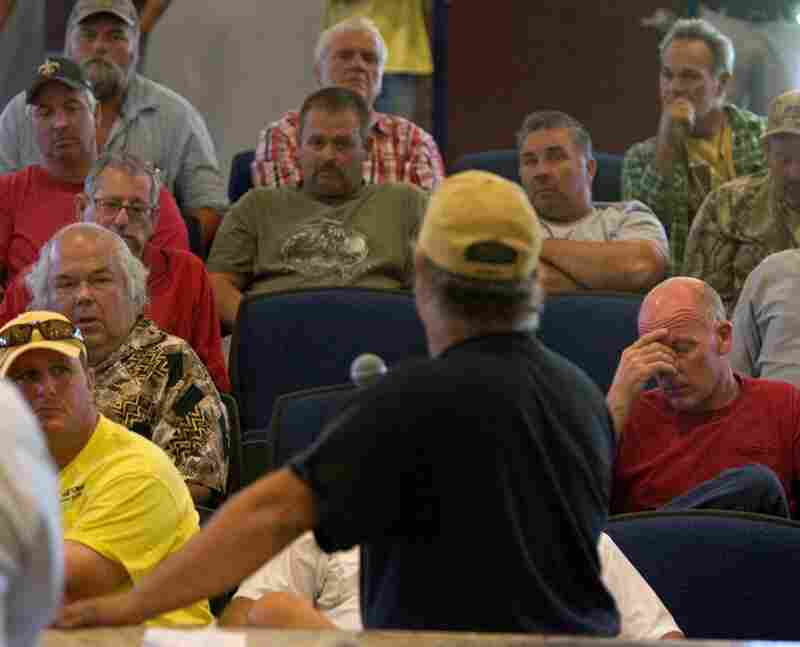 Louisiana fishers gather at the council chambers in Chalmette, La. in an emergency meeting Wednesday, April 28 to see how they can use their resources to help fight the oil spill.