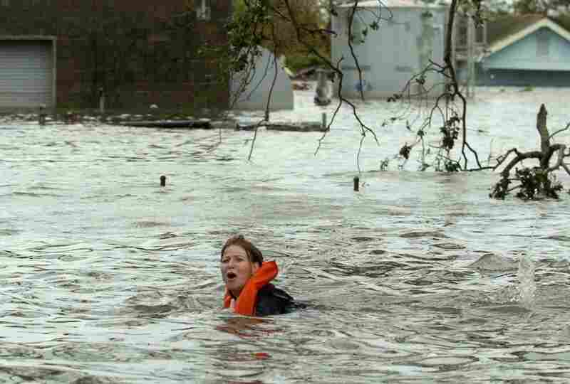 A woman swims down St. Claude, trying to keep in good spirits, saying she was swimming to New Orleans after flood waters inundated the region after Hurricane Katrina.