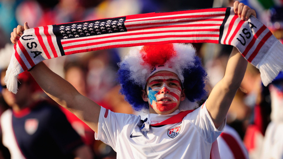 A U.S. fan enjoys the atmosphere ahead of the match against Algeria.