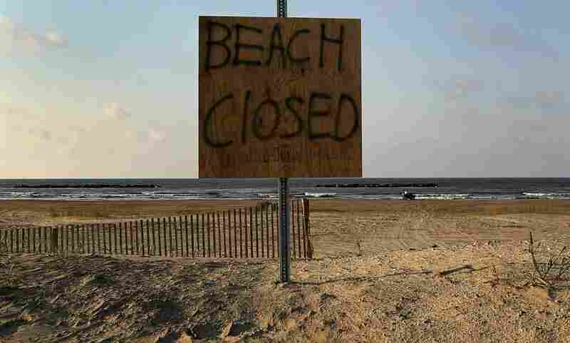A sign warns the public to stay away from the beach on Grand Isle, La. Officials closed the oil-covered beaches to the public indefinitely on Saturday.