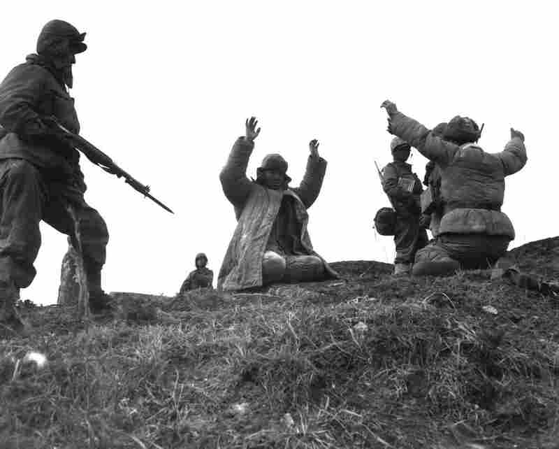 Men of the 1st Marine Division capture Chinese soldiers during fighting on the central Korean front at Hoengsong in March 1951.
