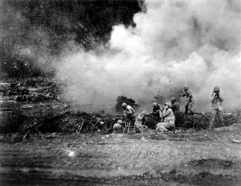 Marines launch a rocket barrage against the Chinese Communists in the Korean fighting in 1951.