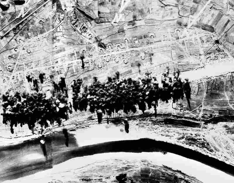 Aerial photographs taken during a bombing run showing the destruction of a North Korean airfield that had been near completion at Saamcham.