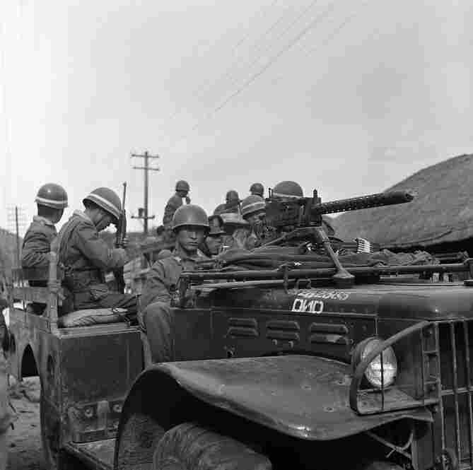 South Korean army troops mount American-supplied military vehicles on June 25, 1950, in response to the invasion of North Korean troops.