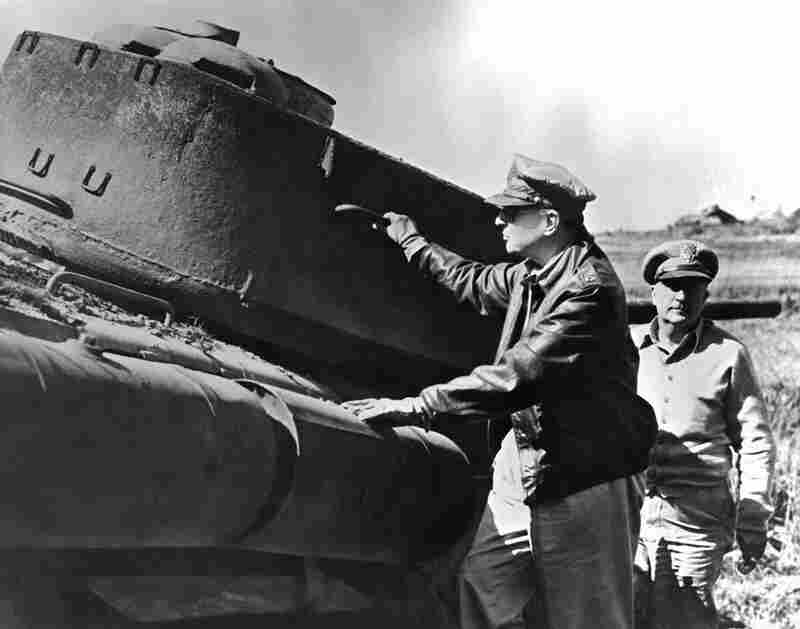 General of the Army Douglas MacArthur, commanding general for the U.N. forces aiding the Republic of Korea, inspects a North Korean tank destroyed during the Inchon landing.