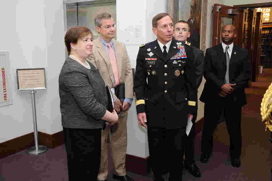 "Kagan and Gen. David Petraeus (center) participate in a pinning ceremony June 3, 2009, for Harvard Law School student Kyle Scherer. Opposition to Kagan has focused partly on her stance on the military; at Harvard, she opposed letting military recruiters on campus because of the ""don't ask, don't tell"" policy."