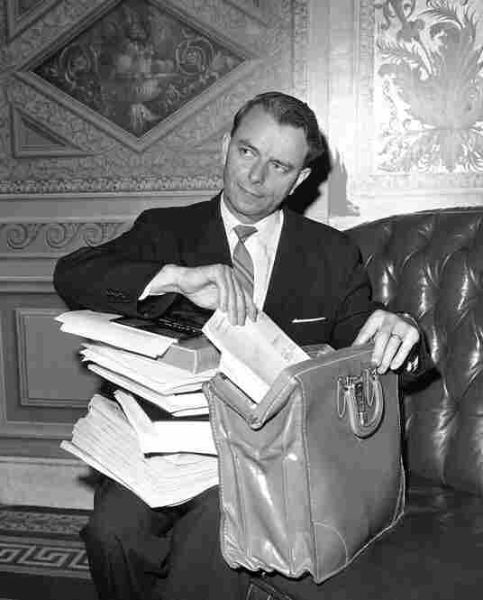 Byrd repacks his briefcase on June 10, 1964, after completing a 14-hour speech during a filibuster of the Civil Rights Act, a move he later said he regretted.