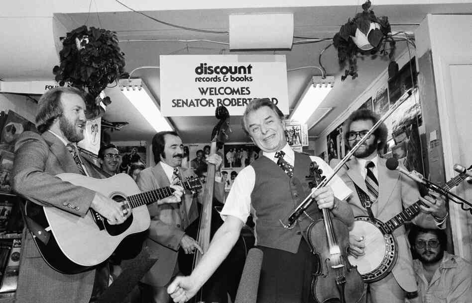 Fiddle in hand, Byrd leads The Country Gentlemen in a song at a Washington record store in 1978. Byrd, who learned the fiddle as a boy growing up in West Virginia, appeared at the store to promote his album Mountain Fiddler.