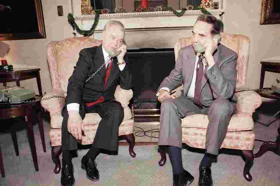 Byrd and Sen. Robert Dole (R-KS) speak to President Reagan in 1985, after the first session of the 99th Congress adjourned. Byrd's time as a senator spanned 11 presidencies.