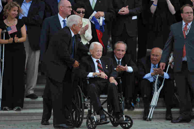 Byrd, seated in a wheelchair, awaits the hearse carrying the remains of Sen. Edward Kennedy in August 2009 in Washington. Byrd and Kennedy served together in the Senate for nearly 50 years.