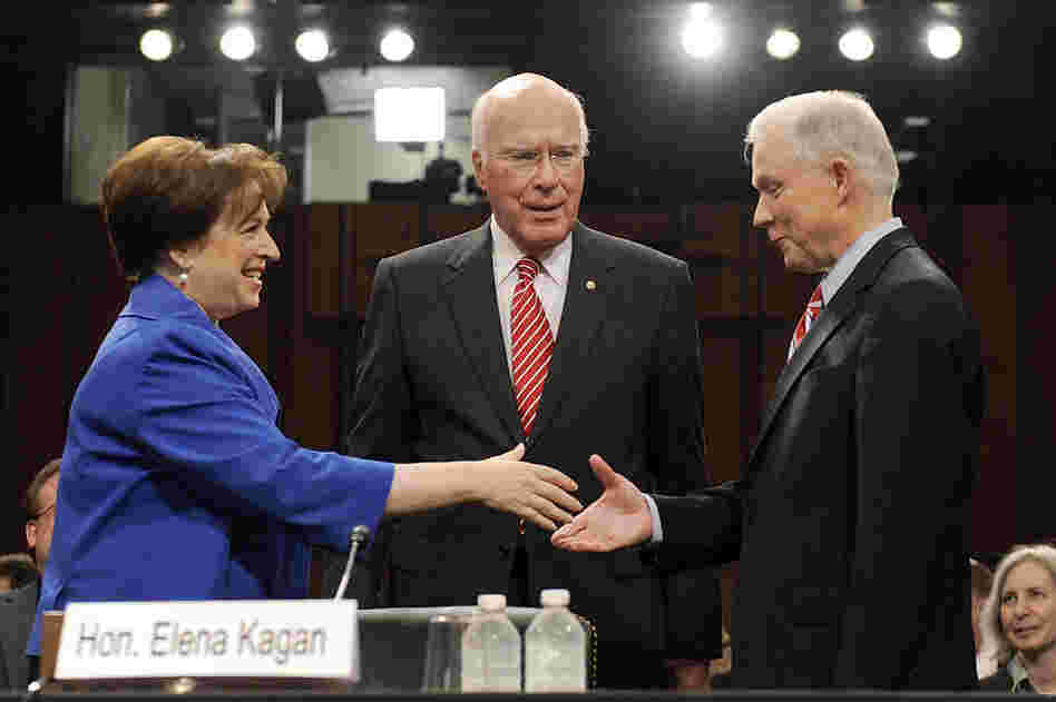 Elena Kagan shakes hands with GOP Sen. Jeff Sessions (right) as Democratic Sen. Patrick Leahy looks on before the start of the confirmation hearing, June 28.