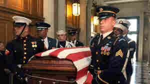 The flag-draped coffin carrying Sen. Rob