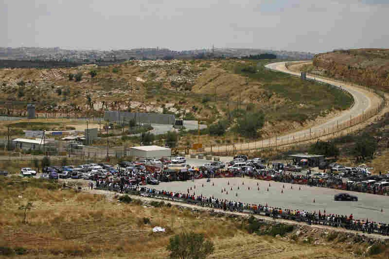 The Speed Sisters race cars in Ramallah. The track is adjacent to the border with Israel and directly next to an Israeli prison that holds Palestinian prisoners.