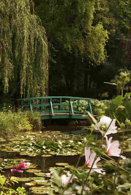 Another view of of Monet's garden as it is today. Monet modeled this part of the gardens, surrounding his house, on Japanese gardens. The artist was an avid collector of Japanese prints, which influenced Impressionism as a whole.
