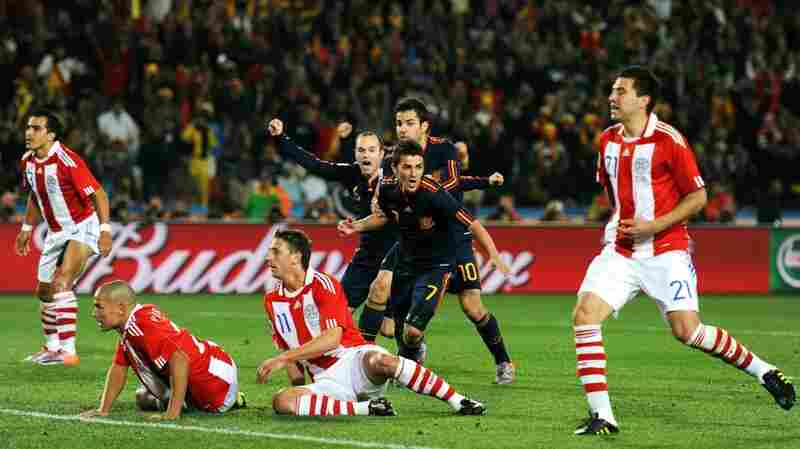 David Villa scores for Spain against Paraguay.