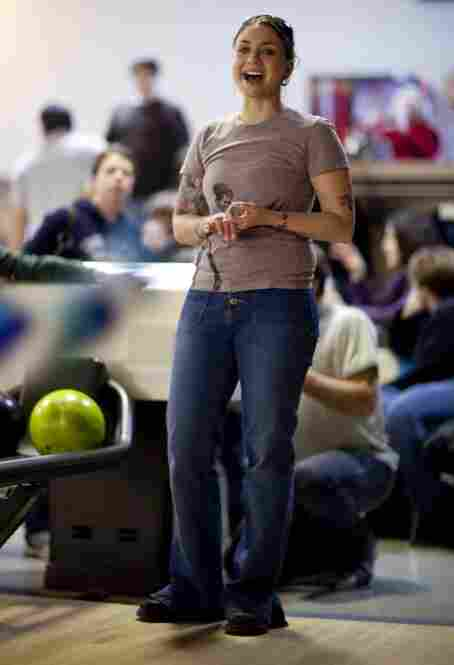 Colleen Segbers cheers for her daughter, Gwenyth Pettitt, 5, while she bowls. Segbers wasn't married when she got pregnant, although she did later marry Gwyneth's father. She loves her husband, she says, but that is not why they decided to get married – they did it because she needed health insurance.