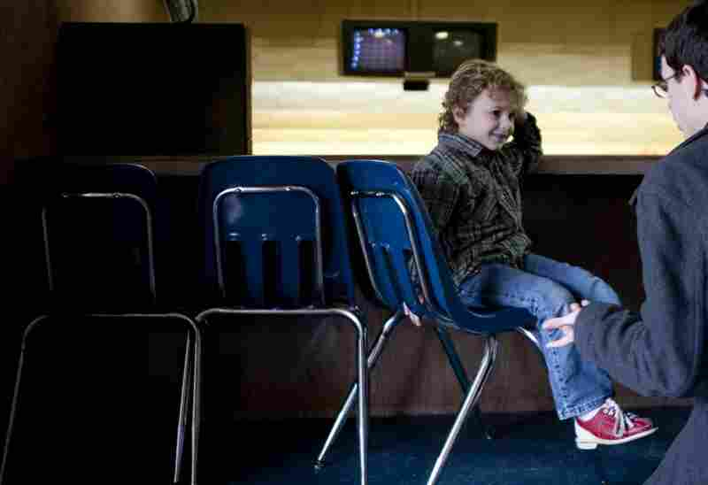 Noah, 6, receives help tying his bowling shoes from his father, Nathan. Noah was born in 2004, but his parents didn't get married until 2009.