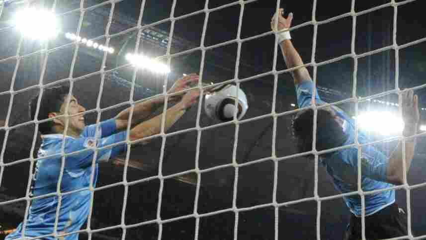 Uruguay's Luis Suarez stops a goal with his hands.