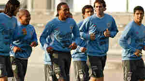 Uruguay's team players run during a training session on July 5.
