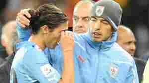 Uruguay's defender Martin Caceres (L) re